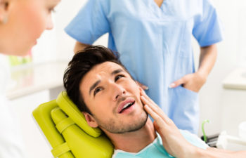 man in the dentist's chair getting a cavity treated