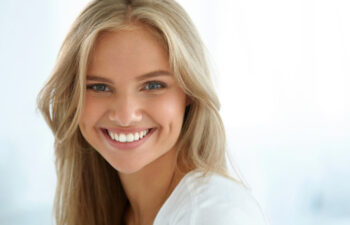 young woman with a big smile from Invisalign